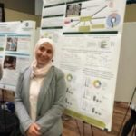 Ilham Alshiraihi with Poster at 2019 Showcase